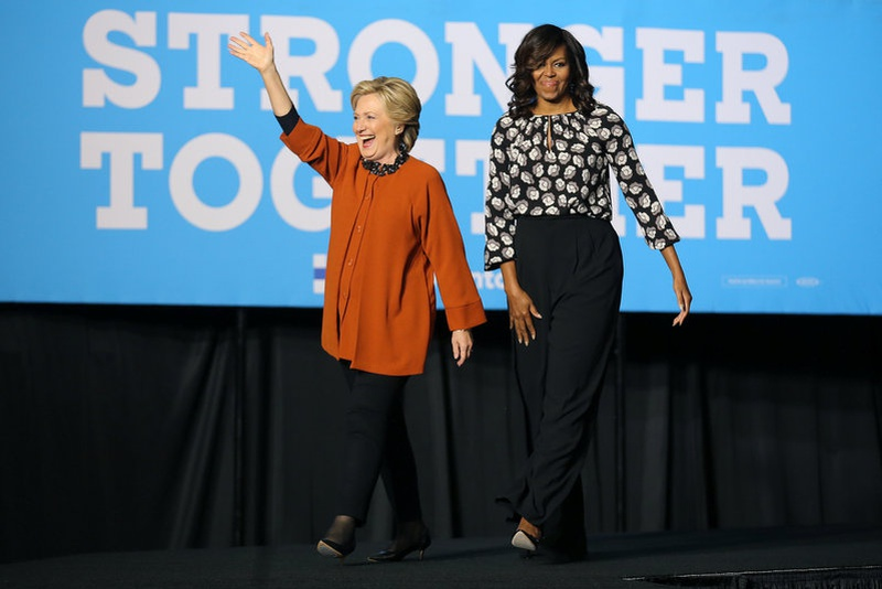 U.S. Democratic presidential candidate Hillary Clinton arrives to a campaign rally accompanied by U.S. first lady Michelle Obama in Winston