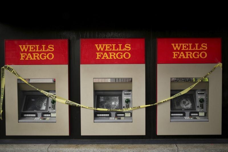 Wells Fargo fails 'living will' test, faces restrictions -regulators