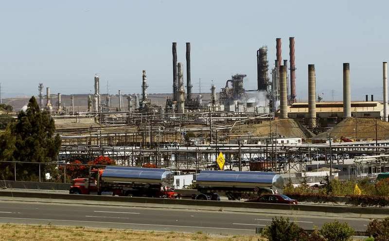 Chevron profit drops on weak oil price, but beats forecasts
