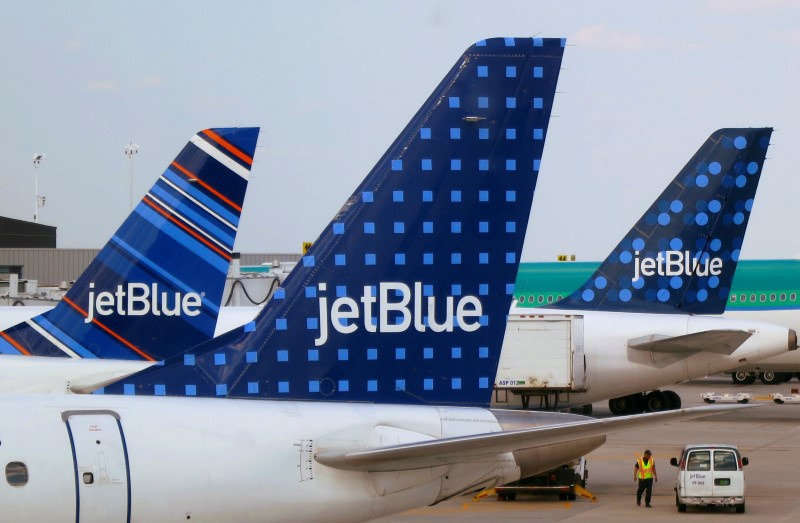 JetBlue to double share buyback as checked bag fees boost revenue