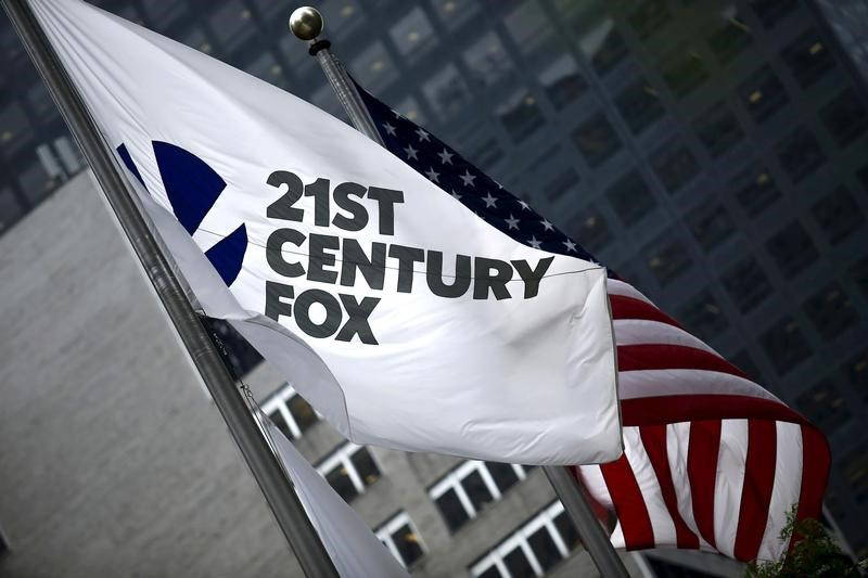 USG Corporation (NYSE:USG), Twenty-First Century Fox, Inc. (NASDAQ:FOXA)