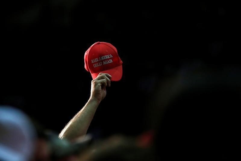Punishment promised for police officers wearing Trump caps