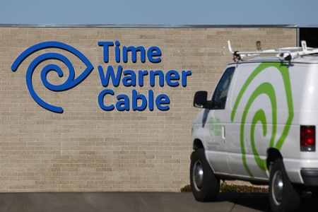 A cable truck returns to a Time Warner Cable office in San Diego, California December 11, 2013. REUTERS/Mike Blake