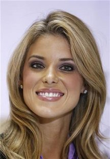 Miss California USA, Carrie Prejean, smiles during a news conference announcing that she would retain her title in New York May 12, 2009. REUTERS/Lucas Jackson