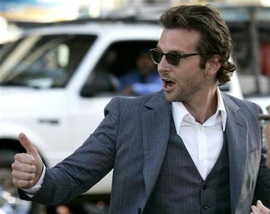 "Cast member Bradley Cooper crosses the street after greeting fans at the Los Angeles premiere of ""The Hangover"" in Hollywood, June 2, 2009. REUTERS/Danny Moloshok"