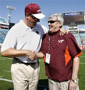 Then Boston College head coach Jeff Jagodzinski (L) and Virginia Tech head coach Frank Beamer talk before the ACC Championship NCAA football game in Jacksonville, Florida December 1, 2007. REUTERS/Mark Wallheiser