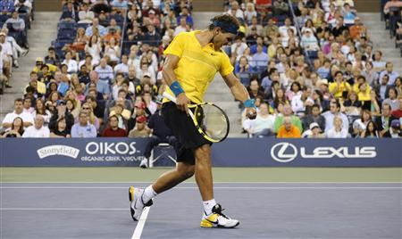 Rafael Nadal of Spain celebrates a point against Nicolas Kiefer of Germany during their match at the U.S. Open tennis tournament in New York, September 4, 2009. REUTERS/Jeff Zelevansky