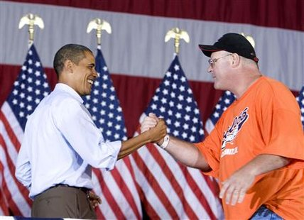 President Barack Obama (L) shakes hands with union member Charlie Dilbert as he attends an AFL-CIO Labor Day picnic at Coney Island in Cincinnati, September 7, 2009. REUTERS/Larry Downing