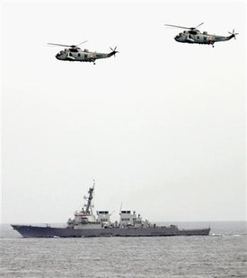 India's Sea Kings helicopters fly over USS. Higgins during the joint exercise between India and U.S. near the western Indian coastal state of Goa September 29, 2005. REUTERS/Punit Paranjpe
