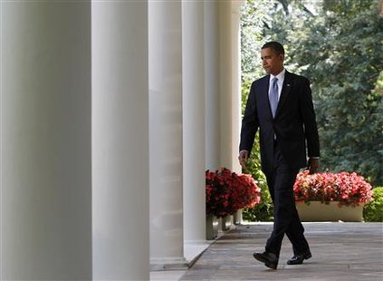 President Barack Obama walks through the Colonnade to make remarks on preparedness and response efforts surrounding the 2009 H1N1 flu virus in the Rose Garden at the White House in Washington, September 1, 2009. REUTERS/Jim Young