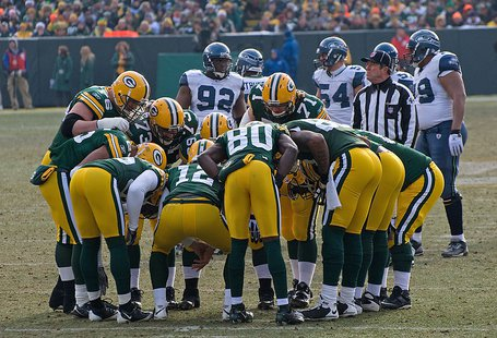 Seattle vs. Green Bay • December 27, 2009 at Lambeau Field in Green Bay, Wisconsin. By Mike Morbeck (Flickr: Green Bay Packers Huddle) [CC-BY-SA-2.0 (http://creativecommons.org/licenses/by-sa/2.0)], via Wikimedia Commons
