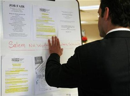 A man looks at job postings at a job fair in New Hampshire, December 17, 2008. REUTERS/Brian Snyder