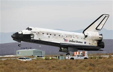 The Space Shuttle Discovery lands at Edwards Air Force Base in California, September 11, 2009. REUTERS/Danny Moloshok