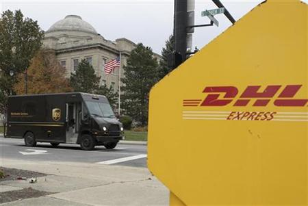A UPS truck drives in front of the Clinton County Courthouse past a DHL drop box in Wilmington, Ohio, November 11, 2008. REUTERS/Jay LaPrete