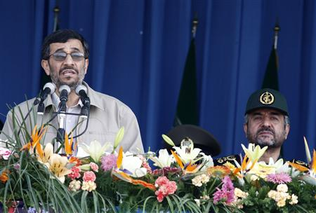 Iranian President Mahmoud Ahmadinejad speaks as Revolutionary Guards commander-in-chief Mohammad Ali Jafari (R) attends a military parade to mark the anniversary of the start of the 1980-1988 Iran-Iraq war in southern Tehran September 22, 2009. REUTERS/Raheb Homavandi