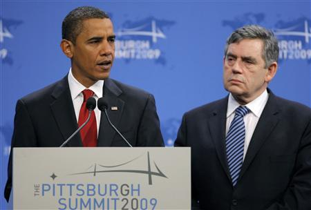 U.S. President Barack Obama (L) speaks at a press conference with British Prime Minister Gordon Brown (R) and France's President Sarkozy (not shown) at the Pittsburgh G20 Summit in Pittsburgh, Pennsylvania September 25, 2009. REUTERS/Brian Snyder