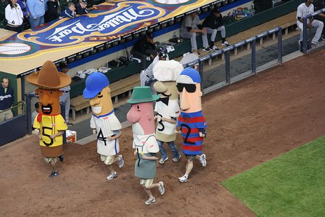 The sausages racing in the Sausage Race at Miller Park. By I, the copyright holder of this work, hereby publish it under the following license: (Own work) [CC-BY-SA-3.0 (http://creativecommons.org/licenses/by-sa/3.0)], via Wikimedia Commons