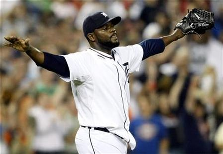 Detroit Tigers closer pitcher Fernando Rodney raises his arms to celebrate the final out against the Seattle Mariners during the ninth inning of their American League MLB baseball game in Detroit, Michigan July 21, 2009. REUTERS/Rebecca Cook