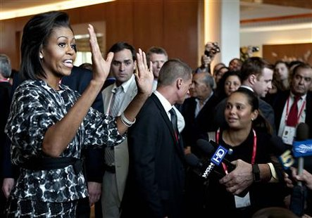 U.S. First Lady Michelle Obama gestures as she arrives at Hotel Marriott in Copenhagen, September 30, 2009. The first lady will support the Chicago delegation in the bid for the Summer Olympic Games 2016. The International Olympic Committee (IOC) will vote on the 2016 Summer Olympic Games on October 2, 2009 in Copenhagen. REUTERS/Scanpix/Nils Meilvang