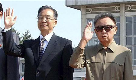 China's Premier Wen Jiabao (2nd L) waves beside North Korea's leader Kim Jong-il (2nd R) after his arrival in Pyongyang in this October 4, 2009, in this picture released by North Korea's official news agency KCNA. REUTERS/KCNA