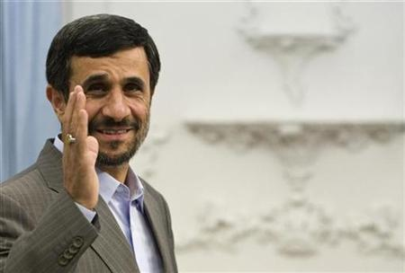 EDITORS' NOTE: Reuters and other foreign media are subject to Iranian restrictions on their ability to film or take pictures in Tehran. Iran's President Mahmoud Ahmadinejad waves as he waits to start an official meeting in Tehran September 29, 2009. REUTERS/Raheb Homavandi