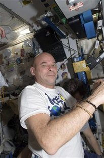 Canadian spaceflight participant Guy Laliberte is pictured in the Unity node of the International Space Station in this photo taken October 5, 2009 and released by NASA October 8, 2009. REUTERS/NASA/Handout