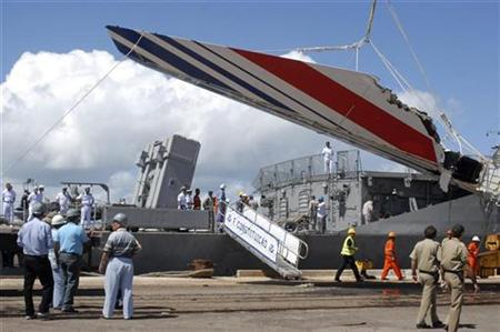 Debris of the missing Air France flight 447, recovered from the Atlantic Ocean, arrives at Recife's port June 14, 2009. REUTERS/JC Imagem/Alexandre Severo
