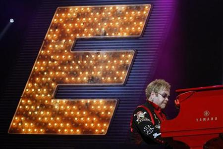 "British singer Elton John performs during his show ""The Red Piano"" at the N.I.A in Birmingham, central England, November 19, 2008. REUTERS/Darren Staples"