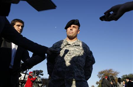Military Police Sgt. Andrew Hagerman, who was a first responder to the shooting at Fort Hood Army Post talks with reporters at Fort Hood Army Post in Fort Hood, Texas November 6, 2009. The death toll from an Army psychiatrist who opened fire at the Fort Hood Army post rose to 13 on Friday, and Army officials said the suspected shooter was hospitalized and on a ventilator. REUTERS/Jessica Rinaldi