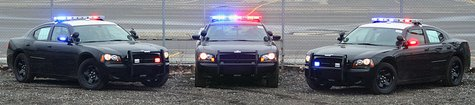 3 Dodge Charger Police Cars with lights and sirens By GPDII at en.wikipedia [Public domain], from Wikimedia Commons
