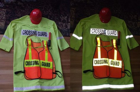 Crossing Guard Outfit with a Hi-Visibility Vest, lanyard with whistle, strobe beacon, raincoat, and Hard-hat. Both pics show usage in normal light, and when light (in this case, from a camera flash) reflects off the clothing By 293.xx.xxx.xx (Own work) [CC-BY-SA-3.0 (http://creativecommons.org/licenses/by-sa/3.0) or GFDL (http://www.gnu.org/copyleft/fdl.html)], via Wikimedia Commons