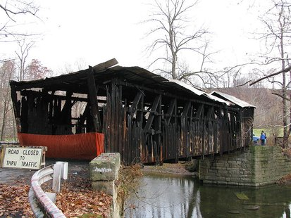 Gudgeonville Covered Bridge after destruction by arson By Amy Matthers (Own work) [CC-BY-SA-3.0 (http://creativecommons.org/licenses/by-sa/3.0) or GFDL (http://www.gnu.org/copyleft/fdl.html)], via Wikimedia Commons