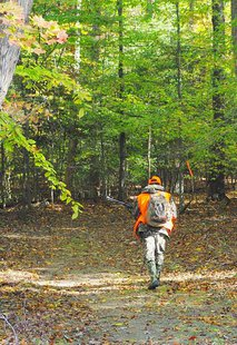 A deer hunter off on an adventure during a controlled wildife management hunt. Courtesy of John Gresham By vastateparksstaff (Hunter on the Trail  Uploaded by AlbertHerring) [CC-BY-2.0 (http://creativecommons.org/licenses/by/2.0)], via Wikimedia Commons