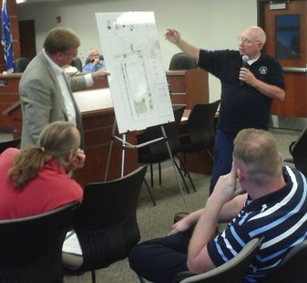 A Madison developer shows off plans for a new Walgreen's at the corner of 17th and Stewart Avenues in Wausau during a September 2009 Plan Commission meeting