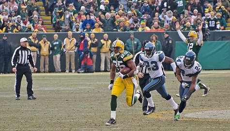 Ryan Grant (25) of the Green Bay Packers breaks loose for a 56-yard touchdown run, with Marcus Trufant (#23) and Deon Grant (#24) of the Seahawks following. Seattle vs. Green Bay • December 27, 2009 at Lambeau Field in Green Bay, Wisconsin. By Mike Morbeck [CC-BY-SA-2.0 (http://creativecommons.org/licenses/by-sa/2.0)], via Wikimedia Commons