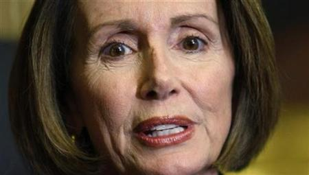 Speaker of the House Nancy Pelosi speaks during a ceremonial swearing in photo session for Congressman-elect Bill Owens of New York in the Capitol in Washington November 6, 2009. REUTERS/Kevin Lamarque