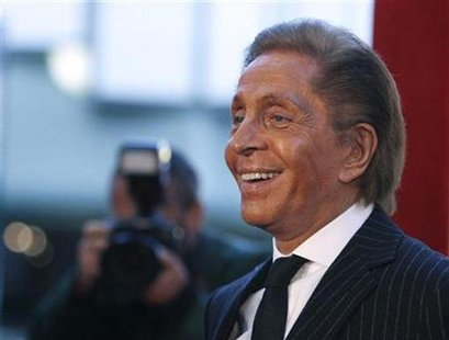 "Italian fashion designer Valentino Garavani poses as he arrives for the West Coast premiere of the documentary ""Valentino: The Last Emperor"" at the Los Angeles County Museum of Art (LACMA) in Los Angeles in this April 1, 2009 file photo. REUTERS/Mario Anzuoni HEADSHOT)"