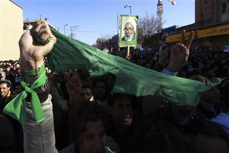 Iranians wearing green wrist bands to show their support to the country's pro-reform opposition attend the funeral of Iran's leading dissident cleric, Grand Ayatollah Hossein Ali Montazeri, in the Shi'ite holy city of Qom, 120 km (75 miles) south of Tehran, December 21, 2009. REUTERS/Stringer/iran