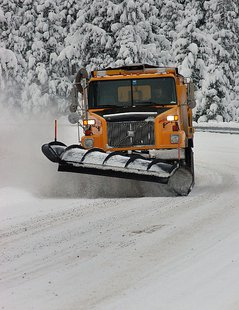 A snowplow at work in the Siskiyous By Oregon Department of Transportation (Snow Plow  Uploaded by AlbertHerring) [CC-BY-2.0 (http://creativecommons.org/licenses/by/2.0)], via Wikimedia Commons