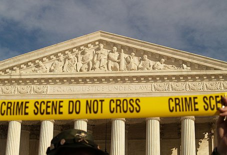 """Crime Scene, Do Not Cross"" Tape At The United States Supreme Court During The January 27, 2007 March On Washington (Washington, DC) By Jim Kuhn [CC-BY-2.0 (http://creativecommons.org/licenses/by/2.0)], via Wikimedia Commons"