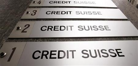 Credit Suisse signs are placed beside the entrance of an office building in Zurich October 22, 2009. REUTERS/Arnd Wiegmann