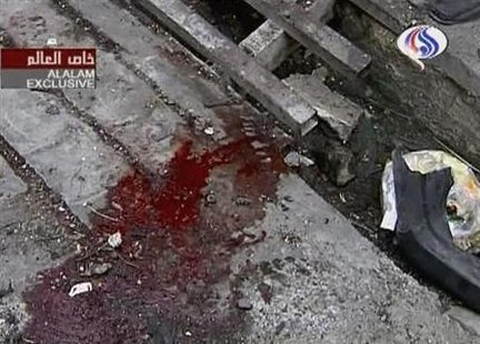 "A video grab of a pool of blood at the site of a bomb blast in Tehran, January 12, 2009. A remote-controlled bomb killed a Tehran University nuclear scientist on Tuesday, media reported, in an attack which the state broadcaster blamed on ""anti-revolutionary"" elements linked to Iran's foreign foes. REUTERS/Al Alam via Reuters TV"