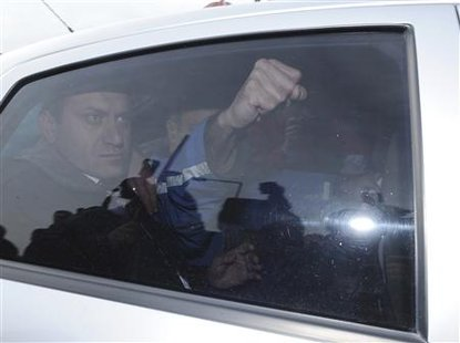 The man who tried to kill Pope John Paul II, Mehmet Ali Agca, makes a fist in a car as he is released from the prison in Ankara January 18, 2009. REUTERS/Stringer