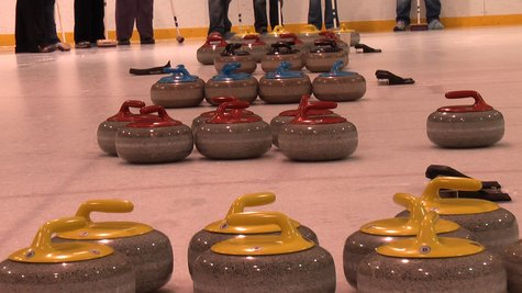 Curling Rocks Sit Idle at Kalamazoo Curling Club members learn the sport Monday night at Wings Stadium.
