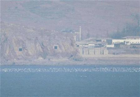 Two caves with coastal artillery (L) are seen at the North Korean village of Haeju where North Korea's military units are stationed in this March 10, 2009 file photo taken from South Korea's Yeonpyeong Island near the western maritime border between the two Koreas, 11 km (7 miles) from North Korea, about 115 km (71 miles) northwest of Seoul and the scene of deadly skirmishes between the two Korean navies in the past. North and South Korea on Jan