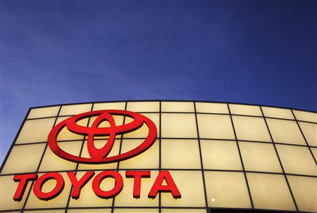 The Toyota logo is lit up above Boch Toyota's dealership in Norwood, Massachusetts January 27, 2010. REUTERS/Brian Snyder