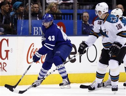 Toronto Maple Leafs forward Nazem Kadri tries to stick handle around San Jose Sharks forward Dany Heatley (R) during the first period of their NHL hockey game in Toronto February 8, 2010. REUTERS/Mike Cassese