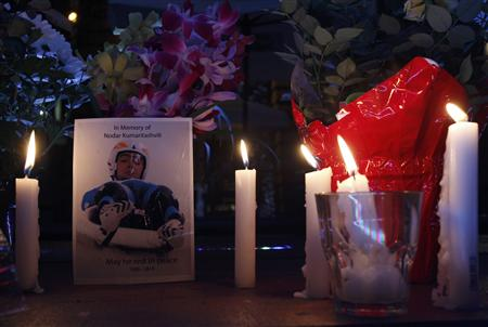 Candles light a memorial for Georgian athlete Nodar Kumaritashvili, in Whistler, British Columbia, February 13, 2010. Kumaritashvili was fatally injured during the final luge training session for the Vancouver 2010 Winter Olympics in the last corner of the track at the Whistler Sliding Centre on February 12, 2010. REUTERS/Tony Gentile