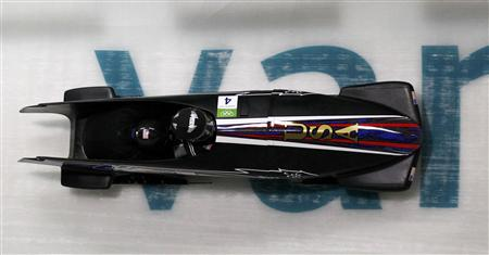 U.S. two-man bobsleigh team, piloted by Steven Holcomb, speeds down the track during the two-man bobsleigh training heats at the Vancouver 2010 Winter Olympics in Whistler February 17, 2010. REUTERS/Pawel Kopczynski