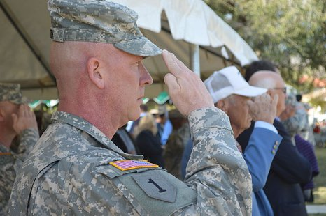 A U.S. Soldier salutes during the presentation of the colors during the Veterans Day observance ceremony at Fort Bliss, Texas, Nov. 7, 2013. By Spc. Alexander Neely [Public domain], via Wikimedia Commons